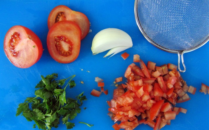 Make fresh salsa and place in strainer.