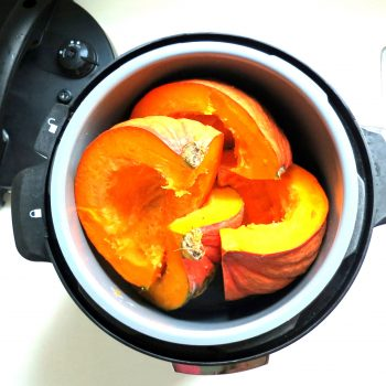 Add water to pressure cooker and insert wedges.